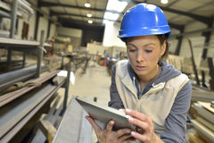 woman-engineer-factory-using-tablet-steel-plant-checking-production-49550869